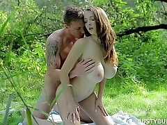 Young busty brunette is making love with her BF in the heart of nature
