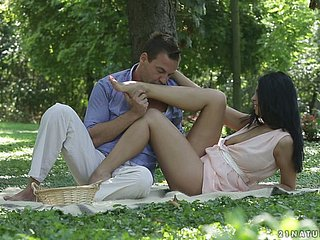 A cute looking couple go for a kinky picnic